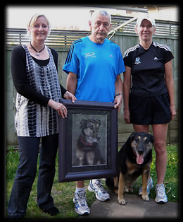 Pet portrait painting of Austin. Artist Karen Neal pictured with owners Bob & Dorothy Cox, and Austin, of Auckland.