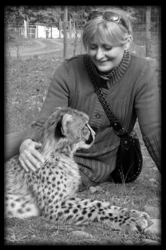 With Mazza, a 6-month-old cub from Orana Park, NZ.